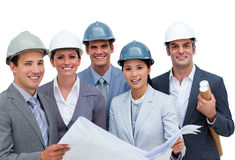International architects studying blueprints Stock Image