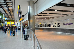 International Arrivals T5 Heathrow airport. People waiting at the International arrivals exit. T5 Heathrow Airport Royalty Free Stock Images