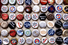 International Beer Caps. A variety of international beer bottle tops on a wall in Tianzifang Shanghai China Royalty Free Stock Photos