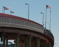 International border in El Paso Santa Fe Bridge flags. royalty free stock images