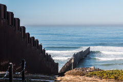 International Border Wall Extending Out Into The Pacific Ocean. And separating San Diego, California from Tijuana, Mexico Stock Image