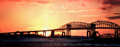 International Bridge Sunset. The International Bridge which crosses the St. Mary's River and connects Sault Ste. Marie, Michigan with Sault Ste. Marie, Ontario Stock Photo