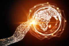 International business and communication concept. Abstract digital hand pointing at glowing illuminated globe on dark background. International business and Royalty Free Stock Photos