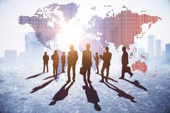 International business and discussion concept. Businesspeople on abstract city background with map and daylight. International business and discussion concept royalty free stock photos