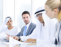 International Business Discussion in Meeting Room Stock Photos