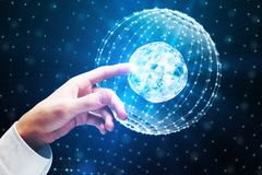 International business and future concept. Hand pointing at polygonal globe on blurry background. International business and future concept. 3D Rendering Stock Images