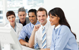 International business group sitting in a line royalty free stock image