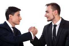 International business partners during handshake stock photography