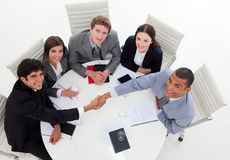 International Business people closing a deal. In a meeting Royalty Free Stock Photos