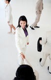 International business people greeting each other. In a business building royalty free stock images