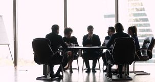 International business people negotiating sitting at office boardroom table
