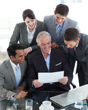 International business people studying a document Stock Image