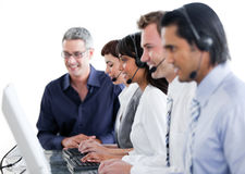 International business people using earpiece Stock Images