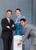 International business people at water cooler. In the office Stock Photo