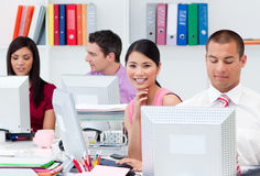 International business people working at computers Stock Photo