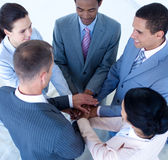 International business team with hands together. High angle of international business team with hands together Stock Image