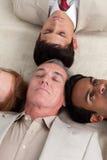 International Business team lying on the floor Stock Image