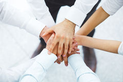 International business team showing unity with their hands toget Stock Photo