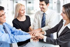 International  business team. Showing unity with their hands together Stock Photos