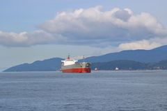 Freighter Anchored Off-Shore Royalty Free Stock Image