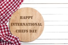 International Chef day greeting card. Cutting board with napkin royalty free stock images