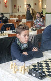 International chess tournament. In Roquetas de Mar in Spain held in January 2016. It is an editorial image. They are playing a boy Stock Image