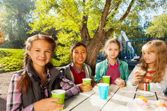 International children drink tea from cups outside royalty free stock photography
