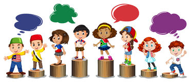 International children standing on log Stock Photography