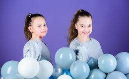 International childrens day. Carefree childhood. Sisters organize home party. Greeting concept. Having fun concept. Balloon theme party. Girls friends near air royalty free stock image