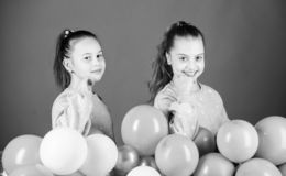 International childrens day. Carefree childhood. Sisters organize home party. Greeting concept. Having fun concept. Balloon theme party. Girls friends near air royalty free stock photography
