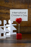 International Childrens Day concept with paper dolls. Stock Photo