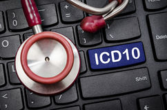 International Classification of Diseases and Related Health Prob. Lem 10th Revision or ICD-10 and stethoscope medical on computer keyboard Stock Images