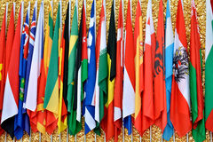 International community with countries flags. Different countries national flags getting together, shown as worldwide, country, and international communication Stock Photography