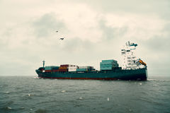 International Container Cargo ship in sea Stock Images