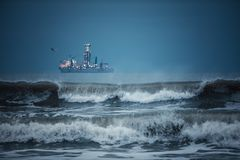 International Container Cargo ship in the sea water after sunset. Freight Transportation, Shipping, Nautical Vessel Royalty Free Stock Photo