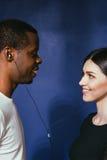 International couple listen music in earphones Royalty Free Stock Photography