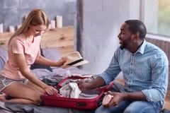 International couple preparing to honeymoon trip Stock Photos