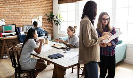 An international creative office people working together stock images