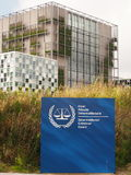 The International Criminal Court entrance sign and the new ICC building Stock Image