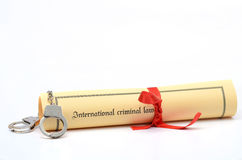 International Criminal Law. Handcuffs and International criminal law document Royalty Free Stock Photography