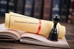 International criminal law and notary seal on a wooden backgrounд. International criminal law, legality concept, notary seal, law and justice concept Stock Image