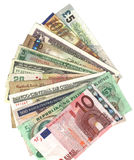 International currencies. Fanned out international currencies on white background Royalty Free Stock Photography