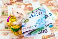 Piggy Bank with money. International currencies background. Money from different countries: euros, rubles. Piggy Bank with money royalty free stock photos