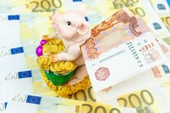 Piggy Bank with money. International currencies background. Money from different countries: euros, rubles. Piggy Bank with money royalty free stock image