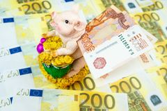 Piggy Bank with money. International currencies background. Money from different countries: euros, rubles. Piggy Bank with money stock images