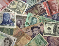 International currency. Bills from Mexico, Peru, Argentina, Uruguay, Philippines, Israel, Egypt, Brazil, Europe, USA, England, Cuba, and Sweden Royalty Free Stock Images