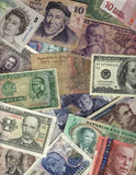 International currency. Portrait oriented international currency: bills from Mexico, Peru, Argentina, Uruguay, Philippines, Israel, Egypt, Brazil, Europe, USA Stock Photos