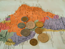 International currency. Money from various countries on world map