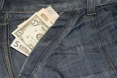 International Currency. Dollars, Euros, Pounds and Kwanzas in jeans pocket Royalty Free Stock Photo