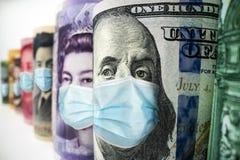 International currency money face mask concept of coronavirus disease COVID-19